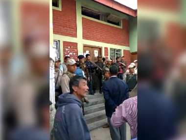 Police controls crowd during postal ballot paper distribution
