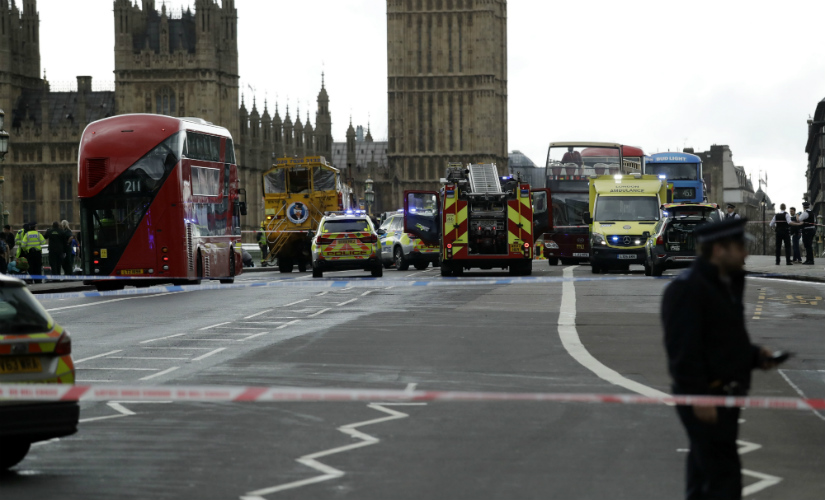 Police secure the area on the south side of Westminster Bridge close to the Houses of Parliament in London. AP
