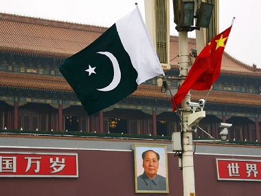 A Pakistan national flag flies alongside a Chinese national flag in front of the portrait of Chairman Mao Zedong on Beijing's Tiananmen Square during Pakistan' Prime Minister Yusuf Raza Gilani's visit May 18, 2011. PM Yusuf Raza Gilani's visit to China from Tuesday allows Islamabad to show it has another major power to turn to just as relations with the United States have faced intense strain after the killing of Osama bin Laden. The visit is part of long-planned celebrations for 60 years of diplomatic ties but the vows of support from Beijing will be especially timely for Islamabad. Reuters