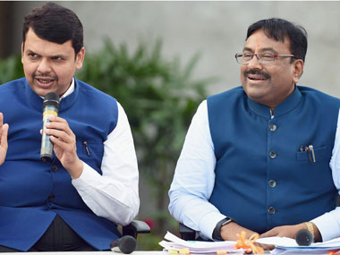 Maharashtra Chief Minister Devendra Fadnavis along with state Finance Minister Sudhir Mungantiwar during a pannel discussion held after announcing Maharashtra budget in Mumbai on Saturday. PTI