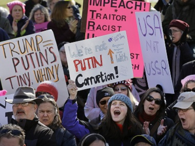 Protesters hold placards and chant slogans during a demonstration against US President Donald Trump. AP