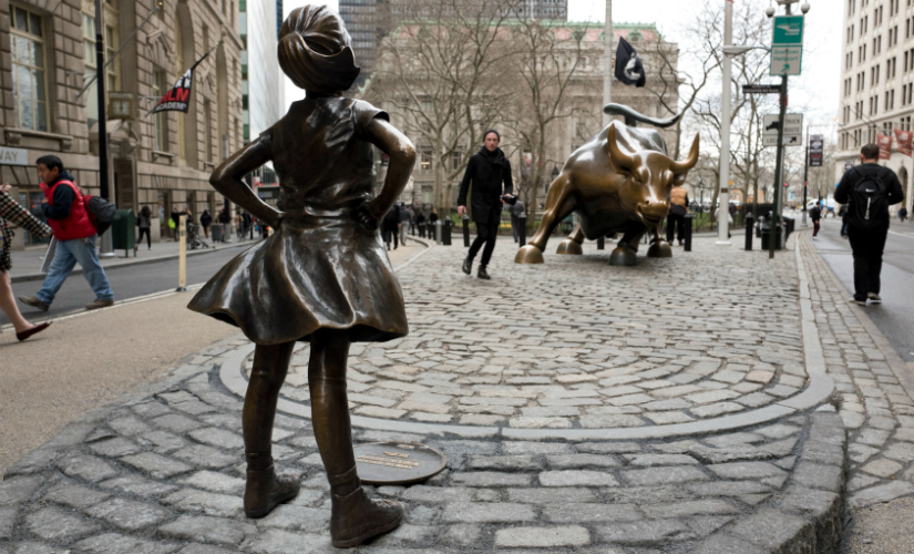 The statue is a symbol for how male dominated the corporate world is. AP