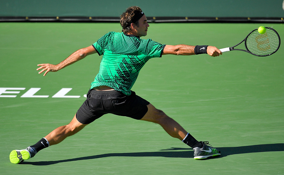Roger Federer, of Switzerland, hits to Stan Wawrinka, of Switzerland, during a final match at the BNP Paribas Open tennis tournament, Sunday, March 19, 2017, in Indian Wells, Calif. (AP Photo/Mark J. Terrill)