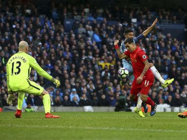 Manchester City's Gael Clichy fouls Liverpool's Roberto Firmino in the box to concede a penalty. AP