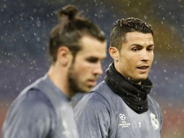 Cristiano Ronaldo (R) and Gareth Bale attend a training session ahead of their Champions League match. AFP