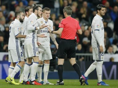 Real Madrid's Gareth Bale protests to the referee after receiving a red card. AP
