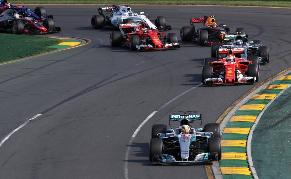 MELBOURNE, AUSTRALIA - MARCH 26: Lewis Hamilton of Great Britain driving the (44) Mercedes AMG Petronas F1 Team Mercedes F1 WO8 leads Sebastian Vettel of Germany driving the (5) Scuderia Ferrari SF70H Valtteri Bottas driving the (77) Mercedes AMG Petronas F1 Team Mercedes F1 WO8 and the rest of the field at the start during the Australian Formula One Grand Prix at Albert Park on March 26, 2017 in Melbourne, Australia. (Photo by Mark Thompson/Getty Images)