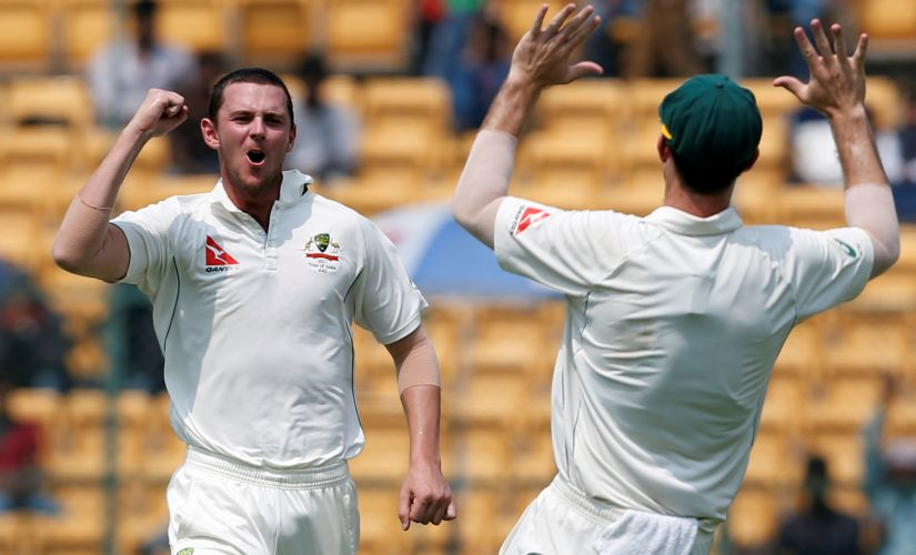 Australia's Josh Hazlewood celebrates the wicket of Ravindra Jadeja. REUTERS/Danish Siddiqui - RTS11LD6