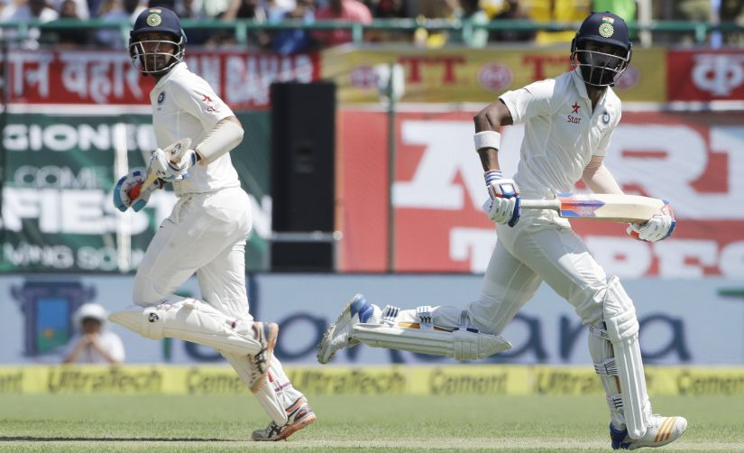 India's KL Rahul, right, and Cheteshwar Pujara run between the wickets on the second day of the Dharamsala Test. AP
