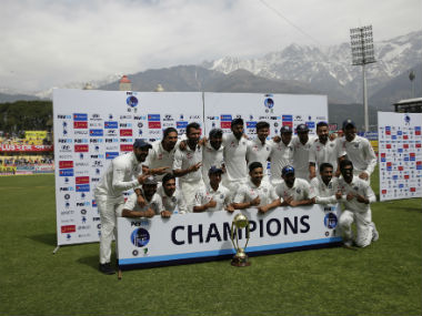 The Indian squad poses with the Border-Gavaskar Trophy after winning the Dharamsala Test by eight wickets. AP