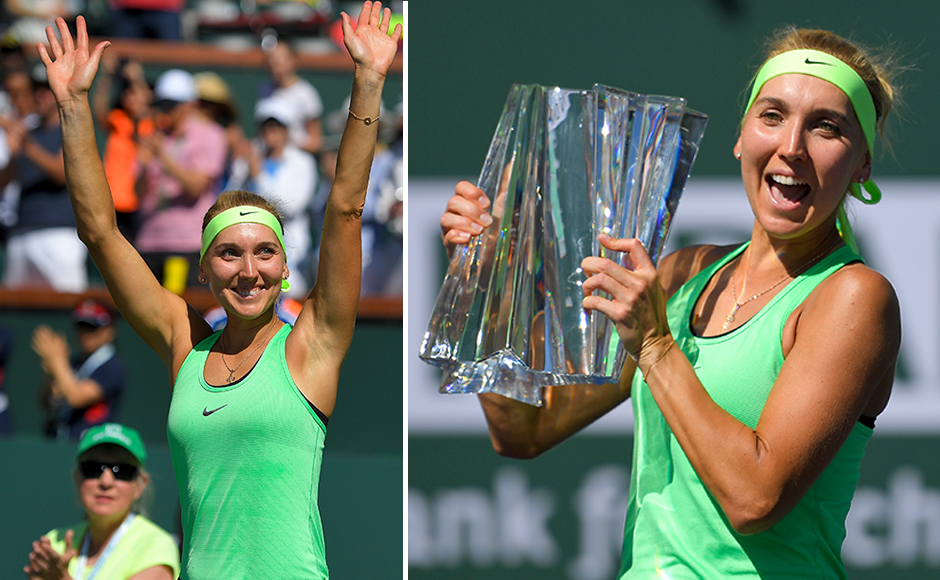 Elena Vesnina, of Russia, poses with the trophy after her win against Svetlana Kuznetsova, also of Russia, in the final match at the BNP Paribas Open tennis tournament, Sunday, March 19, 2017, in Indian Wells, Calif. (AP Photo/Mark J. Terrill)