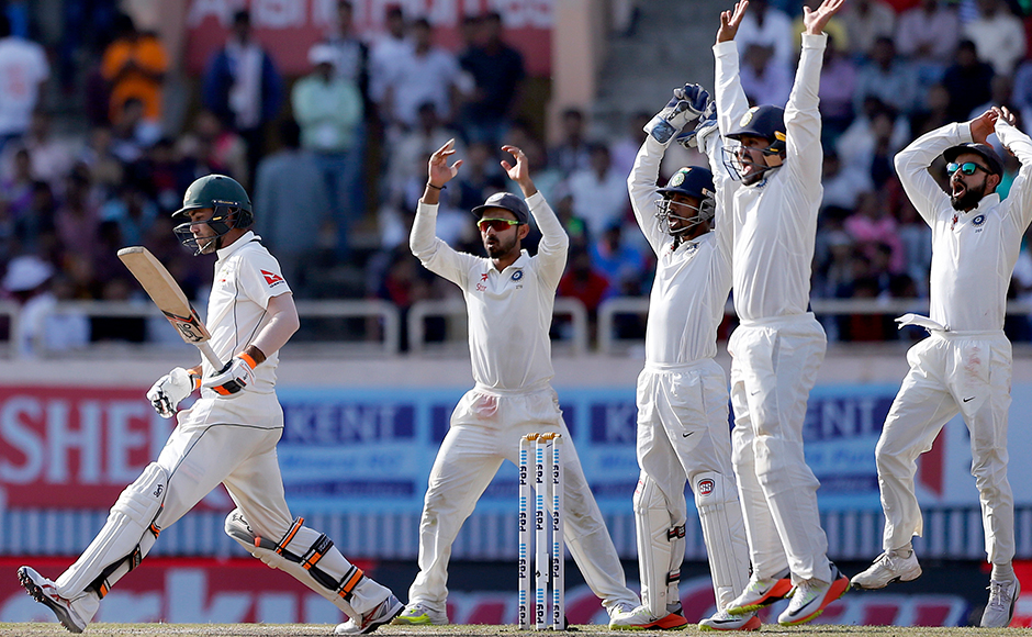 India's captain Virat Kohli, right, and teammates appeal unsuccessfully for the dismissal of Australia's Glenn Maxwell, left, during the fifth day of their third test cricket match in Ranchi, India, Monday, March 20, 2017. (AP Photo/Aijaz Rahi)