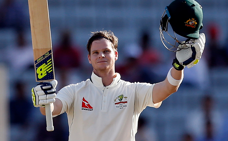 Australia's captain Steven Smith raises his bat and helmet to celebrate scoring a century during the first day of their third test cricket match against India in Ranchi, India, Thursday, March 16, 2017. (AP Photo/Aijaz Rahi)