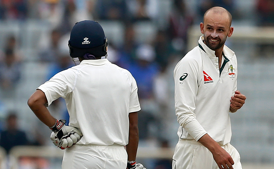 Australia's Nathan Lyon, right, gestures to India's Wriddhiman Saha, left, after bowling a delivery during the fourth day of their third test cricket match in Ranchi, India, Sunday, March 19, 2017. (AP Photo/Aijaz Rahi)