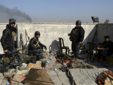 Soldiers take combat positions as Iraqi security forces advance during fighting against IS militants in western Mosul, Iraq. AP