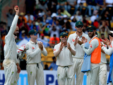 Nathan Lyon gets honoured by his teammates. AFP