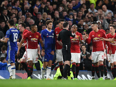 Manchester United players were charged by the FA after misbehaving with match referee against Chelsea. AFP