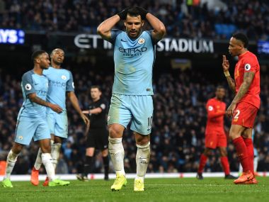Manchester City's Sergio Aguero reacts after missing a goal against Liverpool. AFP