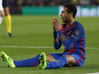 Barcelona's forward Neymar appeals for a foul against PSG. AFP