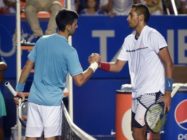 Nick Kyrgios (R) speaks to Novak Djokovic (L) after winning their match. AFP