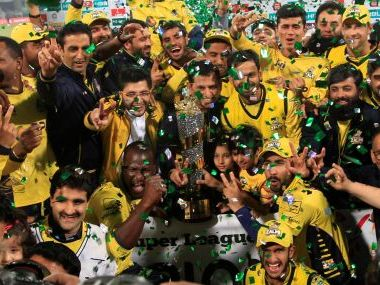 Peshawar Zalmi players celebrate their victory over Quetta Gladiators at the Gaddafi Cricket Stadium in Lahore. REUTERS