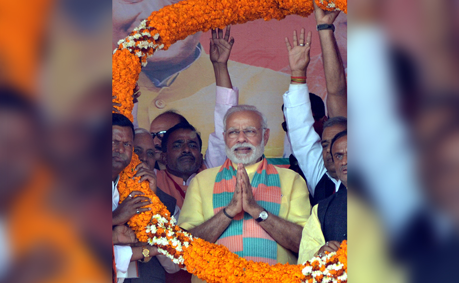 Prime Minister Narendra Modi is garlanded an election campaign rally in favour of BJP candidates in Maharajganj district on Wednesday. PTI Photo (PTI3_1_2017_000212B)