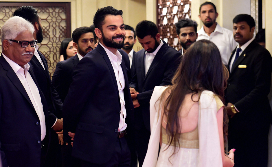 Cricketer Virat Kohli with others during the BCCI Annual awards in Bengaluru on Wednesday. PTI Photo by Shailendra Bhojak(PTI3_8_2017_000358B)