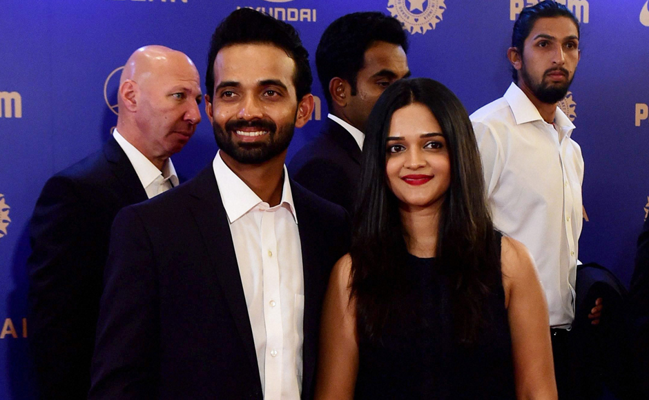 Cricketer Ajinkiya Rahane with wife during the BCCI Annual awards in Bengaluru on Wednesday. PTI Photo by Shailendra Bhojak(PTI3_8_2017_000361B)