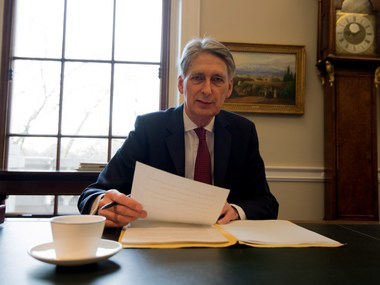 UK's Chancellor of the Exchequer, Philip Hammond, prepares his speech ahead of his 2017 budget annoucement. Getty Images