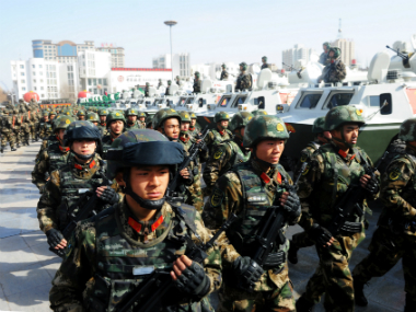 Paramilitary policemen take part in an anti-terrorism oath-taking rally, in Kashgar, Xinjiang Uighur Autonomous Region, China. Reuters