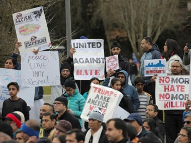 People at a protest rally to speak out against suspected hate crimes against Indian immigrants in the US. Reuters