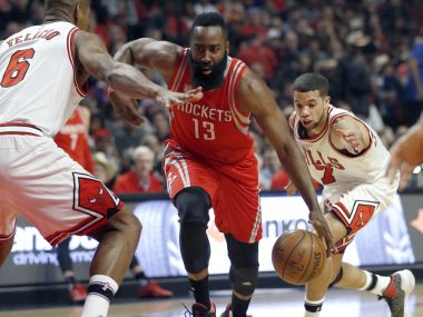 Houston Rockets guard James Harden drives between Chicago Bulls players. AP