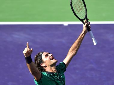 Roger Federer celebrates winning against Stan Wawrinka in the men's singles final. AFP