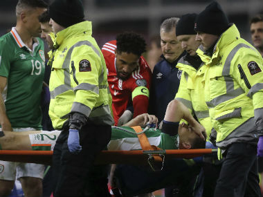 Seamus Coleman is stretchered off the pitch after suffering a leg injury during the Ireland-Wales qualifier. AP