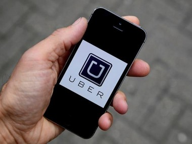 Uber app logo seen on a mobile telephone. Reuters