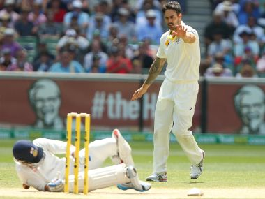 Mitchell Johnson (right) signals to Virat Kohli of India after hitting him with the ball during a run-out attempt during the third Test in December 2014. Getty Images
