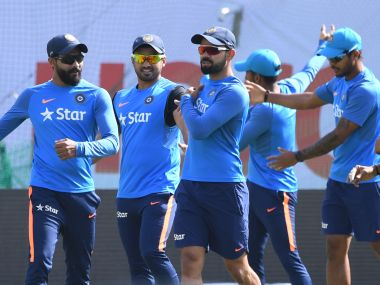 Virat Kohli warms up with teammates during a training session in Dharamsala. AFP