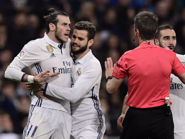 Gareth Bale (L) argues with the referee during La Liga match between Real Madrid and Las Palmas. AFP