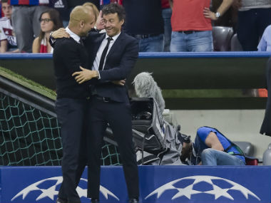 File photo of Pep Guardiola (L) with Luis Enrique. AFP