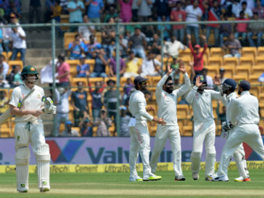 Indian players celebrate the dismissal of Steve Smith (L) during the Day 2 of the second Test against Australia in Bengaluru. AFP