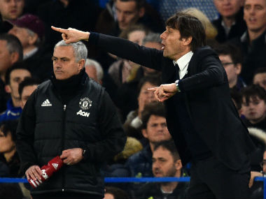 Manchester United manager Jose Mourinho (L) and Chelsea's Antonio Conte during their FA Cup clash. AFP