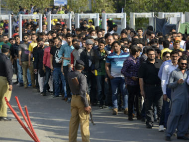 Spectators queue up at one of entry gates of the Gaddafi Stadium for the PSL 2017 held amid huge security. AFP