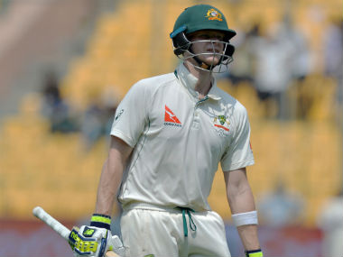 Steve Smith walks back after his dismissal in the second innings in Bengaluru. AFP