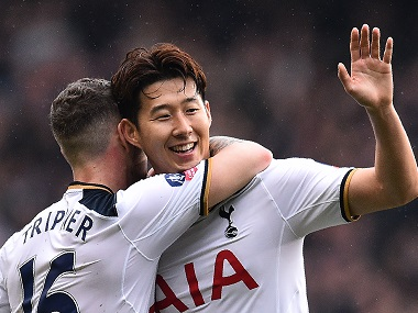 Tottenham Hotspur's Son Heung-Min (right) celebrates scoring his team's second goal against Millwall. AFP