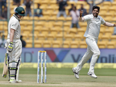 Umesh Yadav celebrates the dismissal of Steve Smith during Day 4 of their second Test in Bangalore. AP