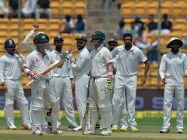 Steve Smith, (C) David Warner and the Indian team wait for the third umpire's decision ion Day 4 of the Bengaluru Test between India and Australia. AFP