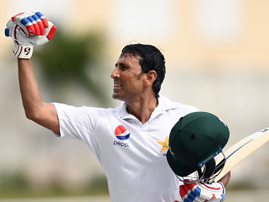 Pakistan's batsman Younis Khan celebrates after reaching his 10,000th run in Test matches. AFP