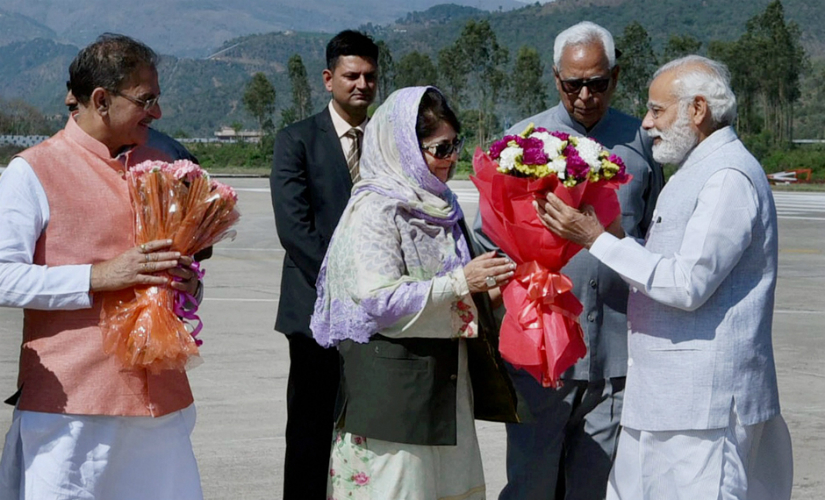 Prime Minister Narendra Modi being received by the Jammu and Kashmir Governor NN Vohra and the chief minister Mehbooba Mufti upon his arrival in the state on Sunday. PTI