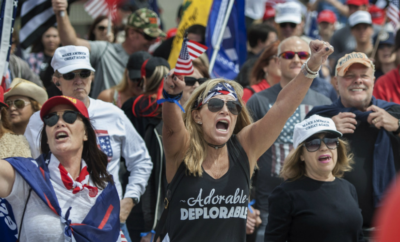 """Wearing her """"Adorable Deplorable"""" tee, Deanne Payn, center, with Sheila Ponce, left, take part in a pro-President Donald Trump rally in Huntington Beach, Calif., on Saturday, March 25, 2017."""