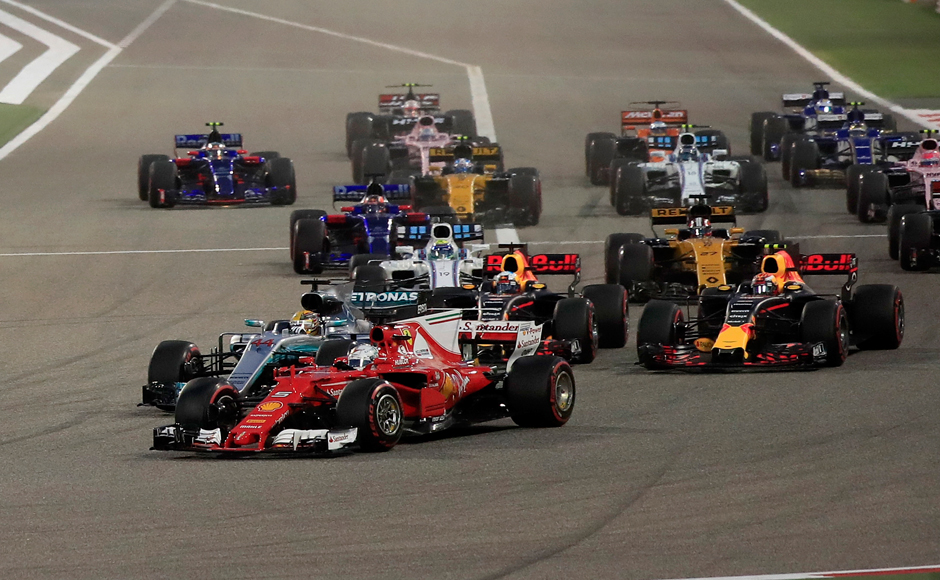 Ferrari driver Sebastian Vettel of Germany, foreground, overtakes Mercedes driver Lewis Hamilton of Britain, 2nd left, entering the first curve at the start of the Bahrain Formula One Grand Prix, at the Formula One Bahrain International Circuit in Sakhir, Bahrain, Sunday, April 16, 2017. (AP Photo/Hassan Ammar)